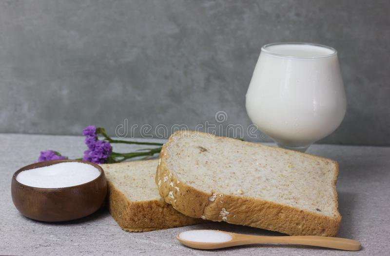 Bread with milk and Purple lavender bouquet and Salt in Cup made of wood stock images