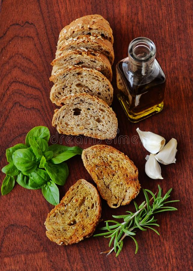 Bread oil and herbs royalty free stock photos