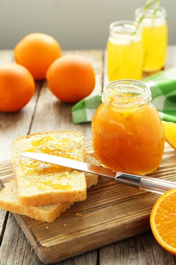 Bread with orange jam stock image