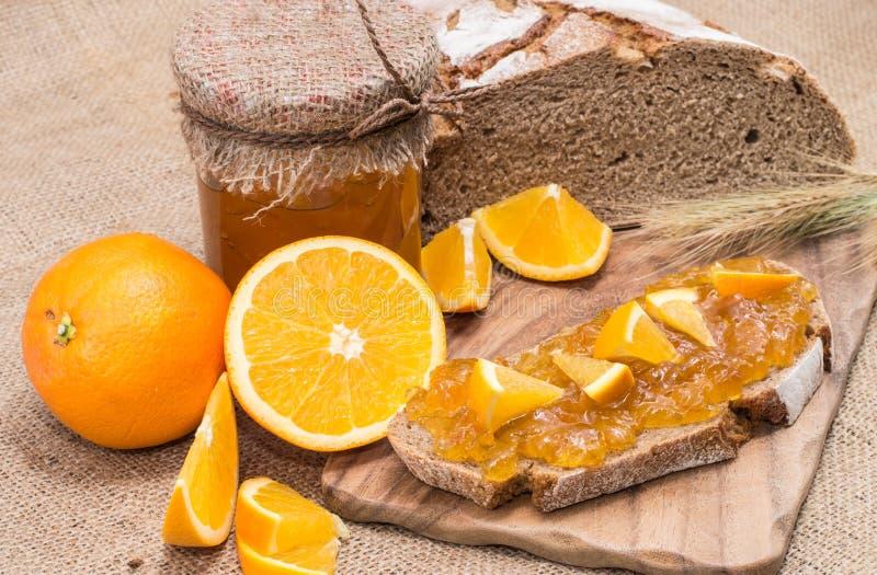 Bread with Orange Jam (rustic background) stock photo