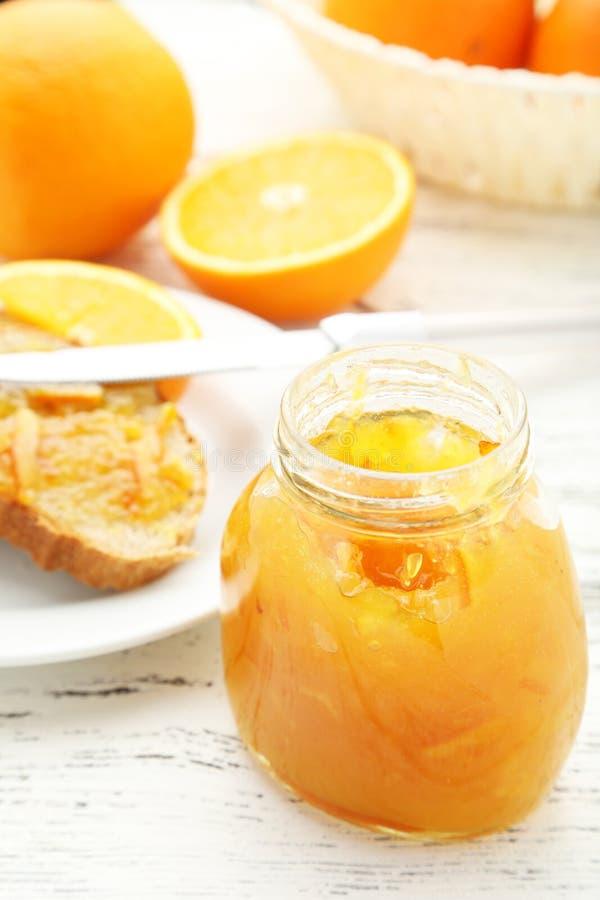 Bread with orange jam stock photography