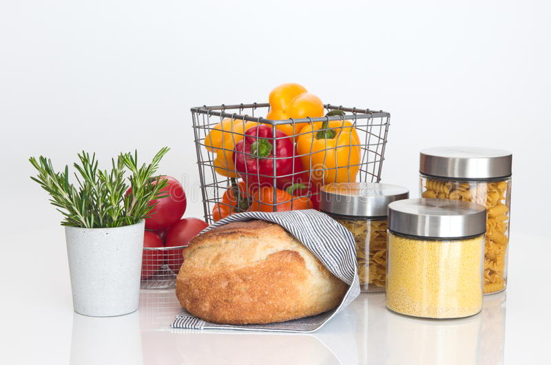 Bread, pasta, millet, vegetables and rosemary. On white background stock photos
