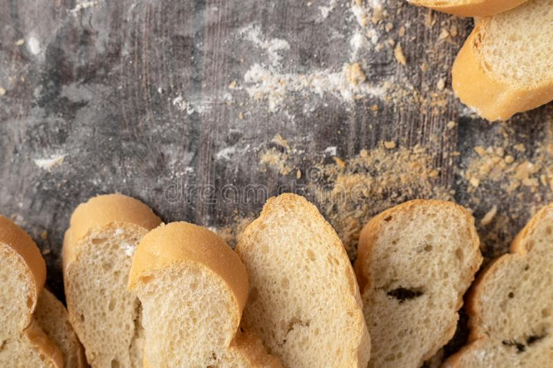 Bread and pastry flour on a wooden table royalty free stock images