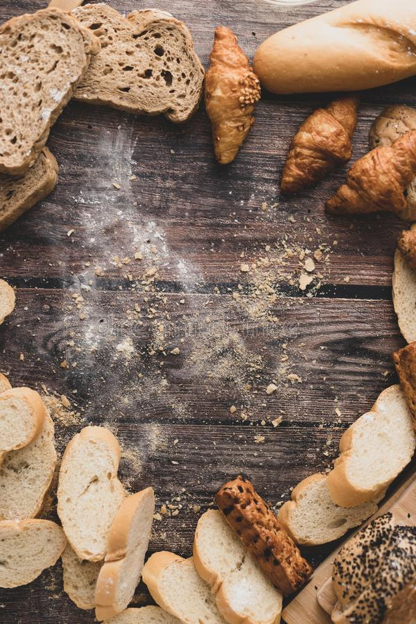Bread and pastry powder on a wooden table royalty free stock photography