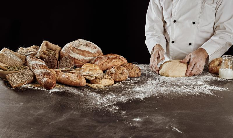 Bread preparation concept with baked loaves royalty free stock photos