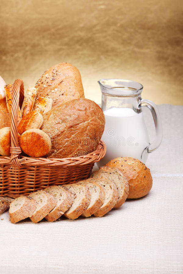 Download Bread Products In Basket And Jug Of Milk Stock Photo - Image: 26118992