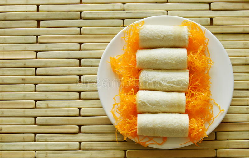 Bread roll golden threads applied dessert on dish royalty free stock images