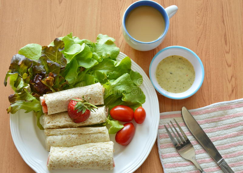 Bread roll and salad dipping sauce with coffee for breakfast royalty free stock photos