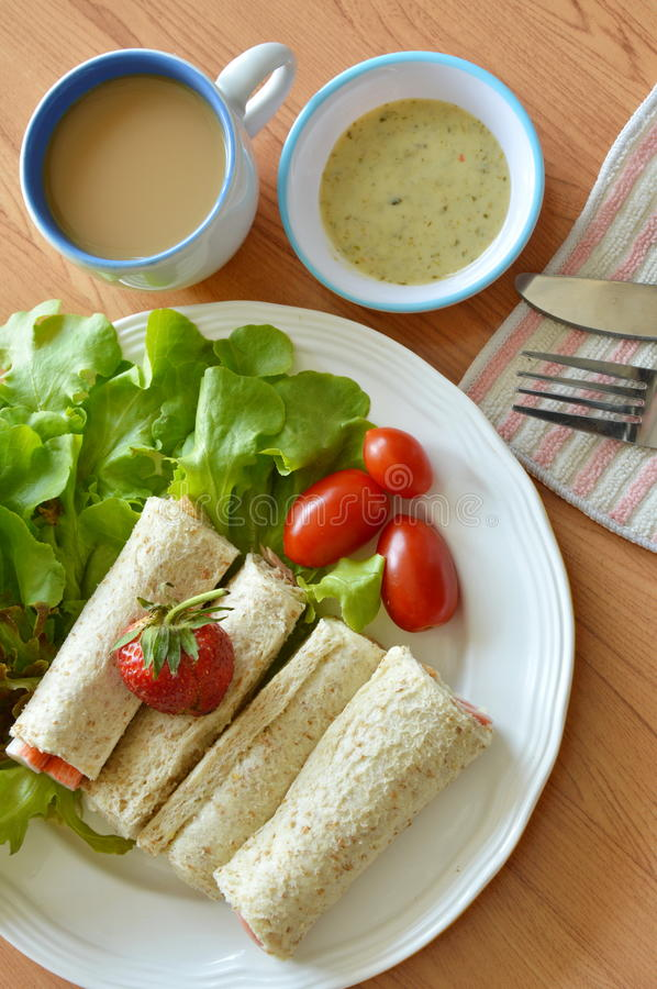 Bread roll and salad dipping sauce with coffee for breakfast royalty free stock photography