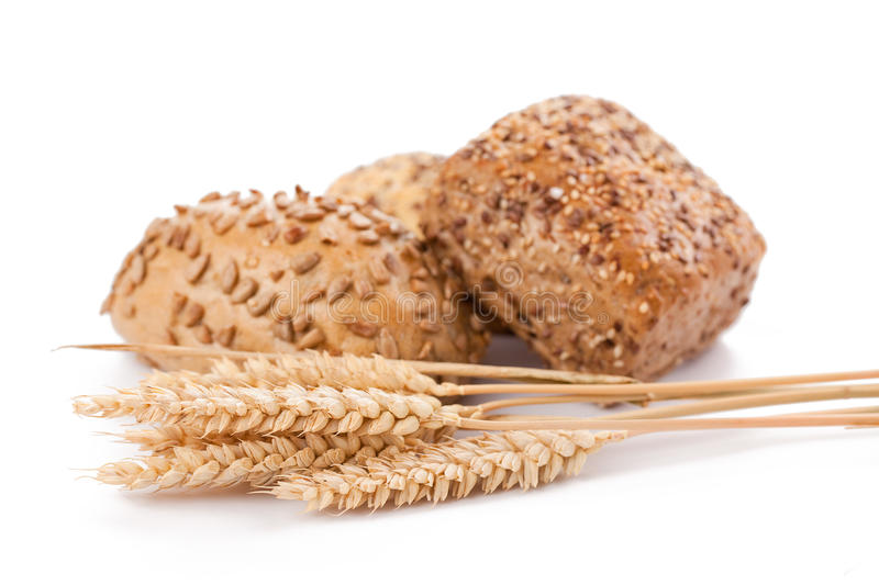 Bread rolls and wheat royalty free stock photo