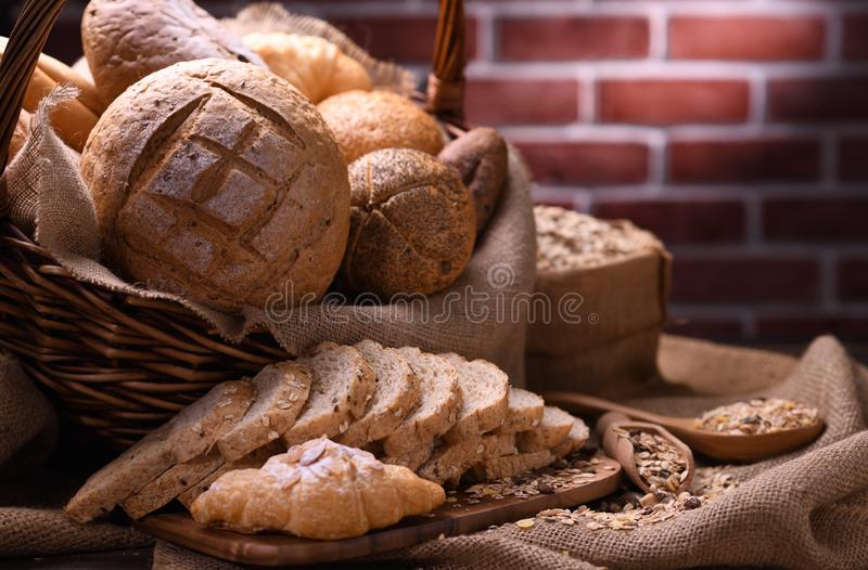 Bread and rolls in wicker basket stock images