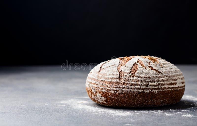 Bread rye, whole grain on a grey slate background. Copy space. Bread rye, whole grain on a grey slate background. Copy space stock image