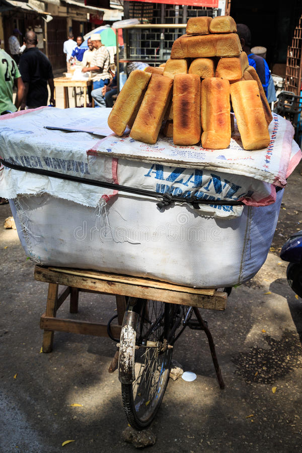 Bread for sale on an african market. Bread for sale on a market in the streets of Zanzibar royalty free stock images