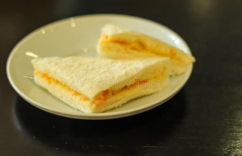 Bread sandwich in a white plate. Bread sandwich in a white plate on the table royalty free stock photos