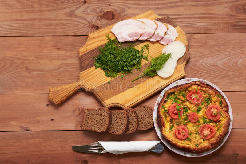 Bread, scrambled eggs, bacon on a table. Bread, scrambled eggs, bacon on wooden table royalty free stock photography