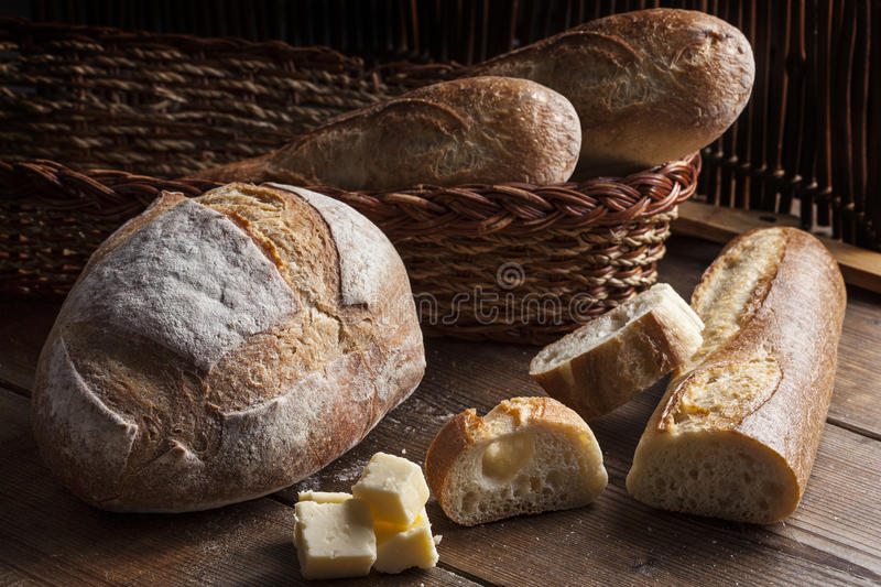 Bread selection on a wooded table royalty free stock image