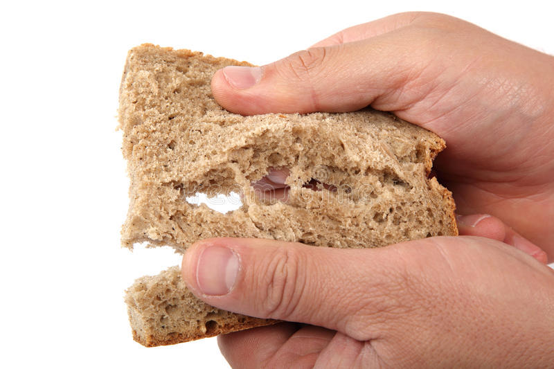 Bread slice in hands on white background. stock photo
