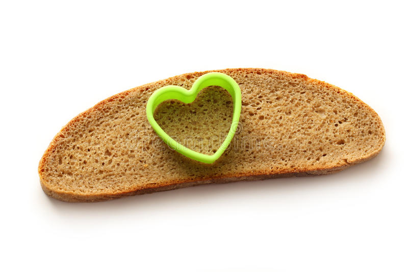 Bread slice and heart royalty free stock images