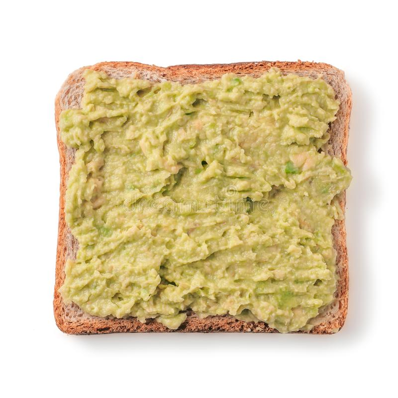 Bread slice with mashed avocado isolated on white stock photos