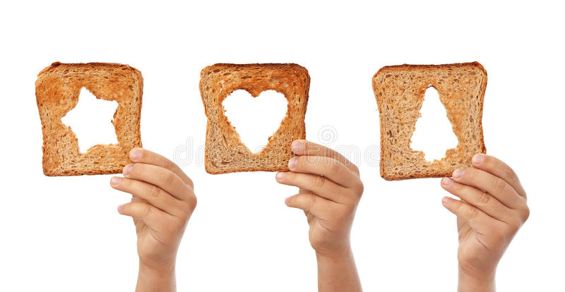 Bread slices with christmas symbols cutouts stock photos