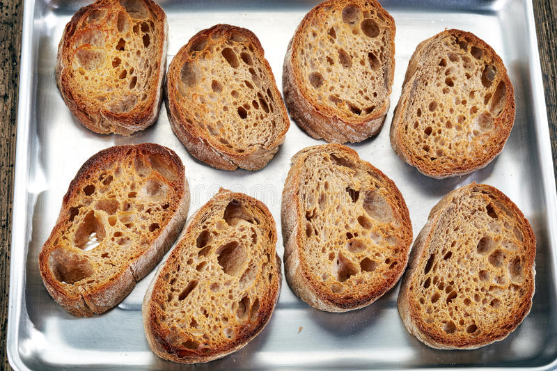 Bread slices on pan royalty free stock photography