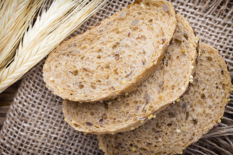 Bread. Slices of bread on a wooden background stock photography