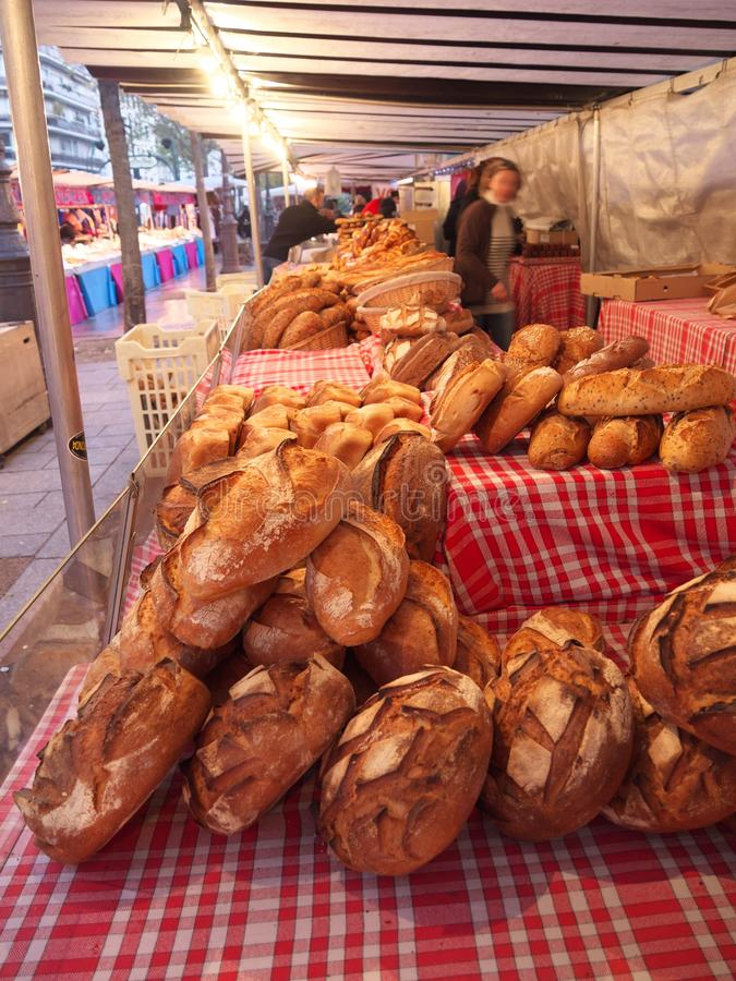 Bread sold at Street market in Paris. People walking and buying food stock photos