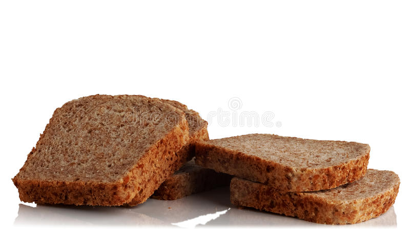 Bread from sprouted grains. Cut into pieces a loaf of bread from sprouted grains on a white background stock image
