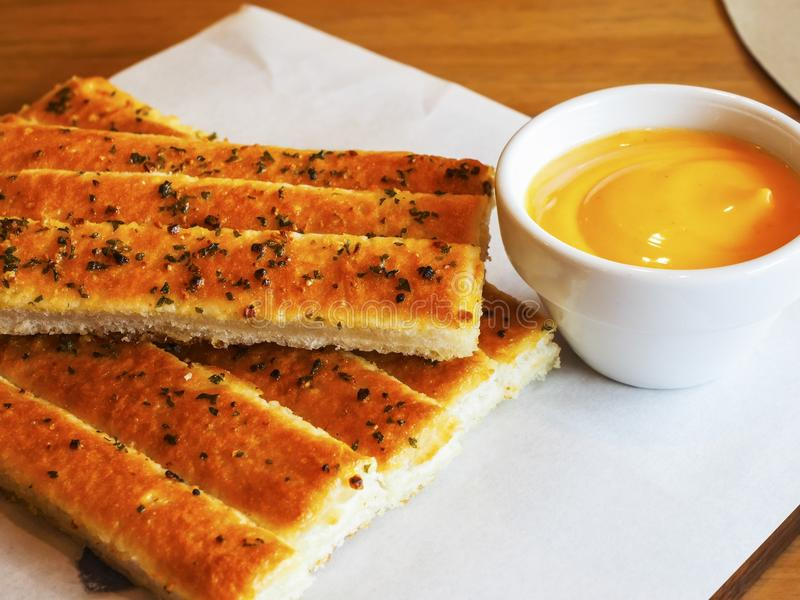 Bread stick. Breadsticks may be offered at the table in restaurants as an appetizer. In some instances or regions they may be a type that is larger than pencil stock photography