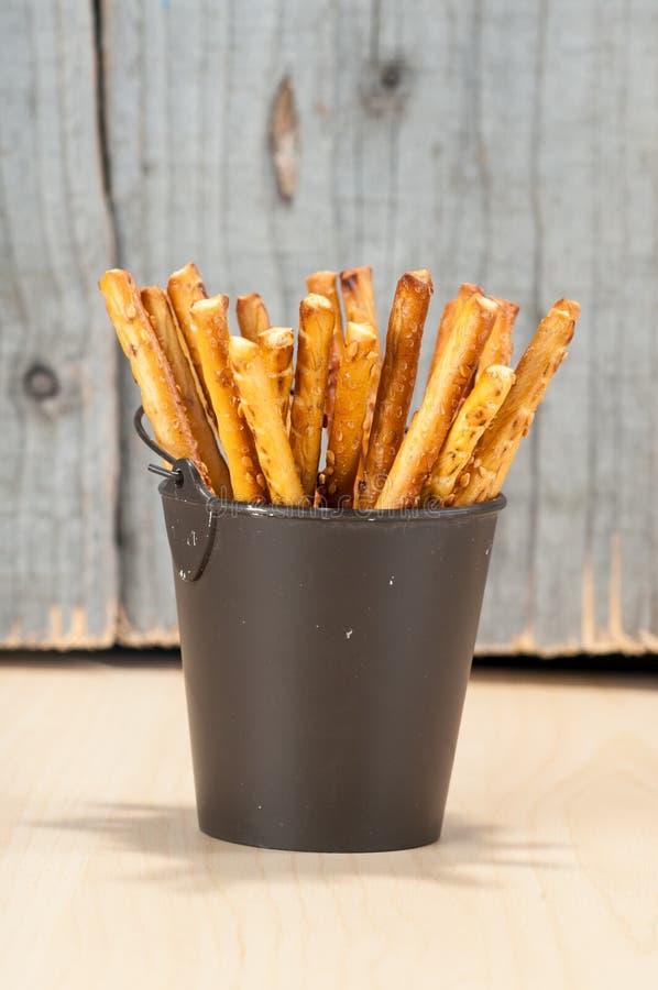 Bread Sticks in a bucket royalty free stock photos