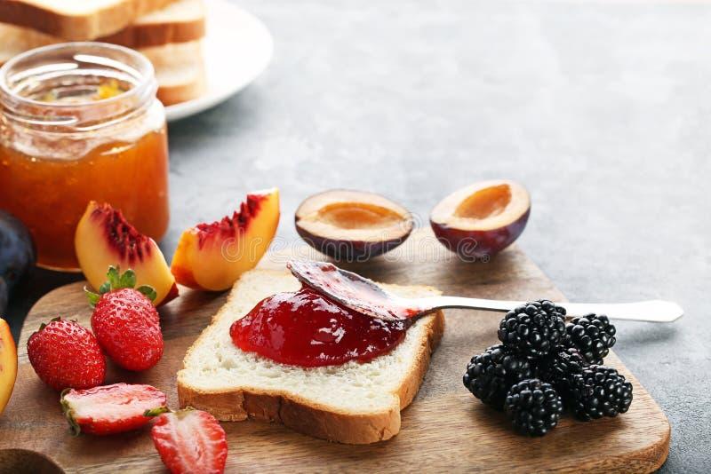 Bread with strawberry jam stock photo