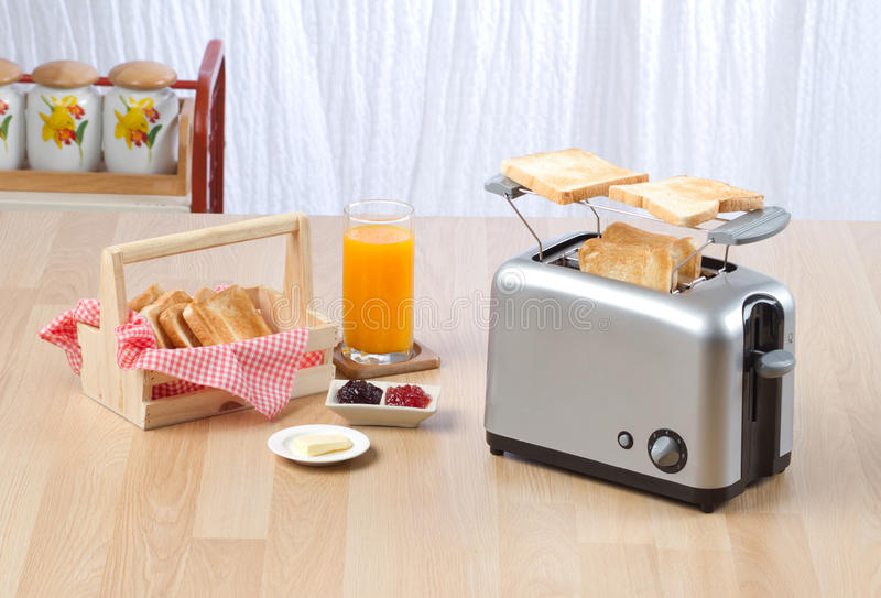 Bread toaster. The kitchenware you need for preparing your breakfast royalty free stock photos