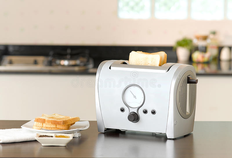 Bread toaster. The kitchenware you need for preparing your breakfast stock photography