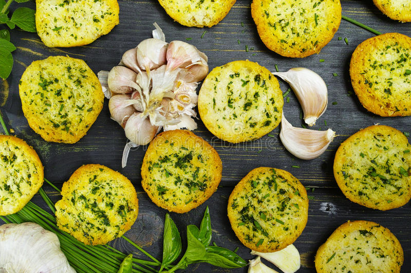 Bread toasts with basil, chives and garlic stock photography