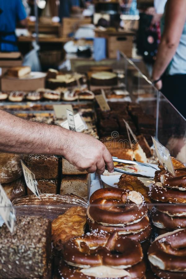 Bread and a variety of pastries on sale at Borough Market, London, UK. royalty free stock image