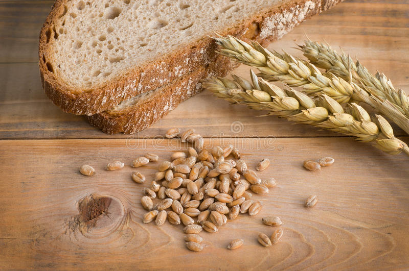 Bread and wheat. On wood stock image