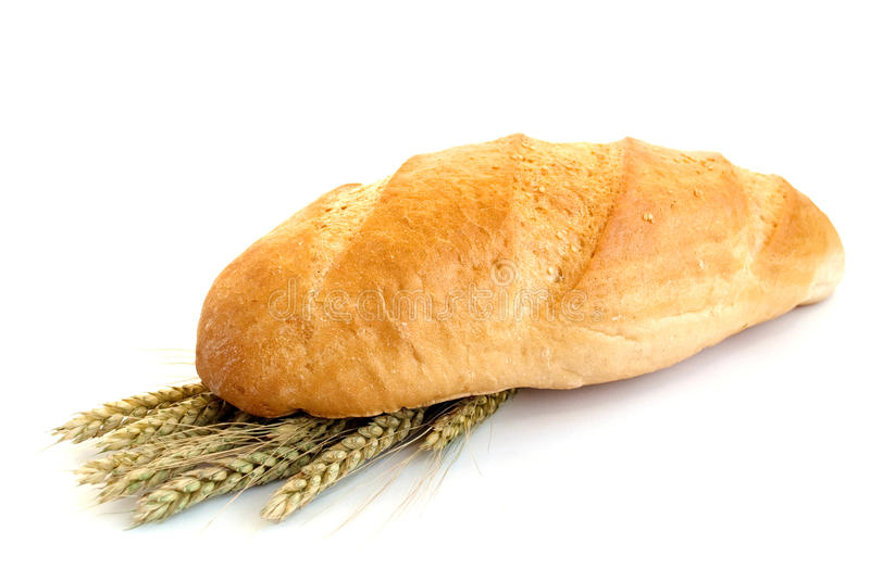 Bread with wheat cones. On a white background stock images