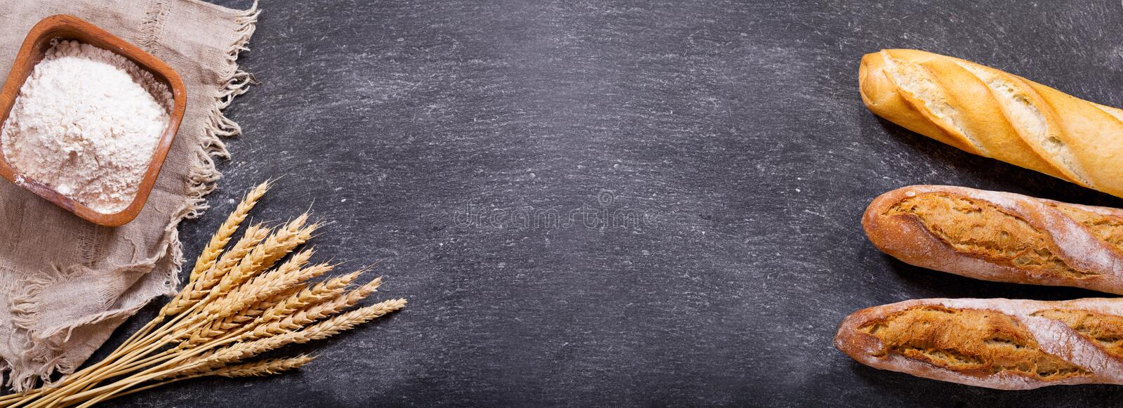 Bread with wheat ears and bowl of flour royalty free stock images