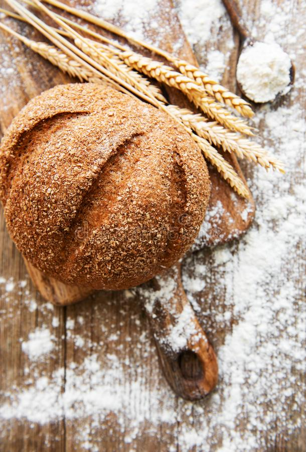 Bread with wheat ears and flour stock photography
