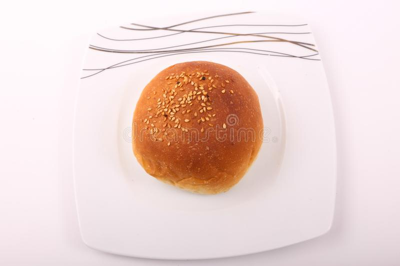 Bread. On white plate on white background stock image