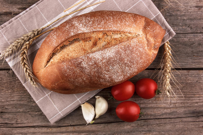 Bread on a wooden board stock images