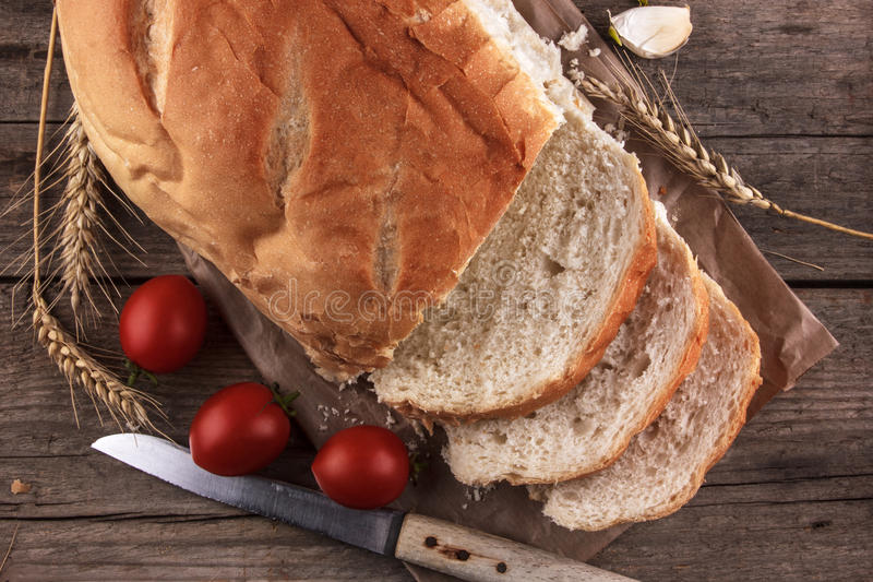 Bread on a wooden board. And tablecloth royalty free stock photo