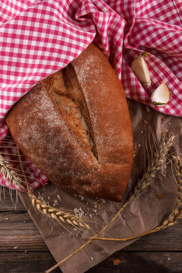 Bread on a wooden board stock photo