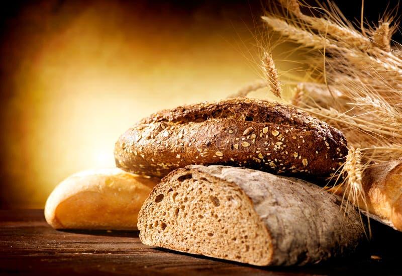 Bread on a Wooden Table stock photos