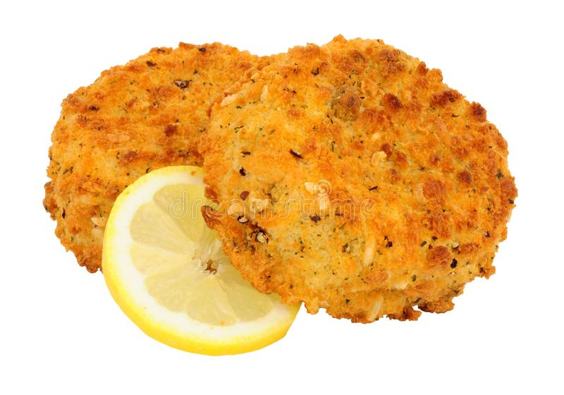 Breadcrumb covered salmon fish cakes. Isolated on a white background stock image