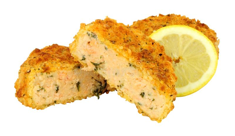 Breadcrumb covered salmon fish cakes. Isolated on a white background royalty free stock photos