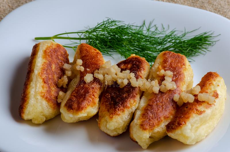 Breaded cheese and kefir sticks served in white plate. stock photo