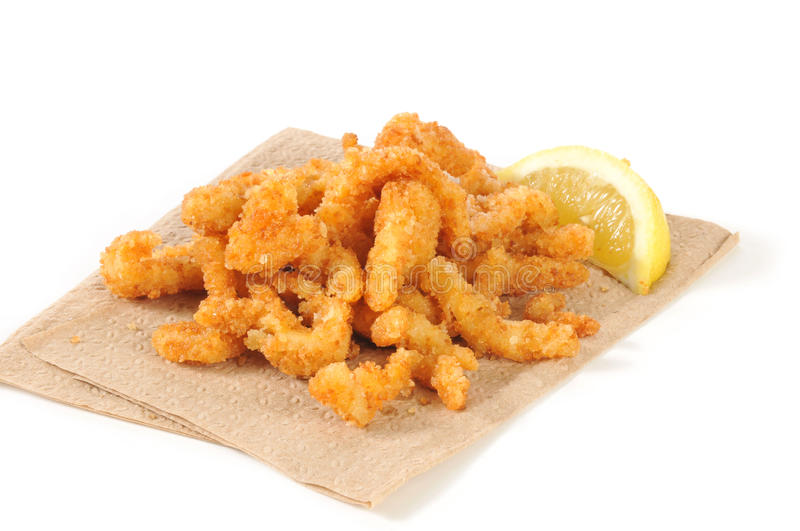 Breaded strips. Breaded deep fried strips of clams on an unbleached napkin royalty free stock photography