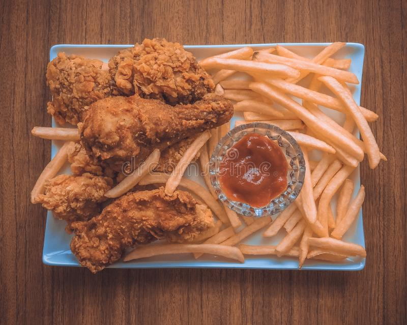 Breaded Crispy fried kentucky chicken tasty dinner.Close up Gourmet Main Dish for Dinner with Crispy Fried Chicken. Plate of fried chicken with french fries on stock images