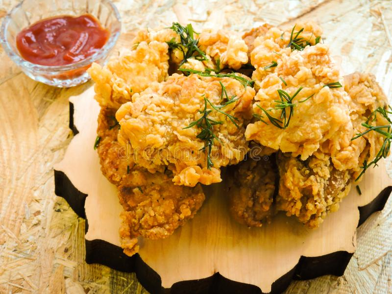 Breaded Crispy fried kentucky chicken tasty dinner.Close up Gourmet Main Dish for Dinner with Crispy Fried Chicken. Plate of fried chicken with french fries on royalty free stock image